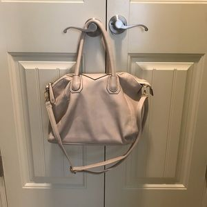 Street level purse, cream with black. Like new.